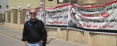"""Outside courthouse with banners calling for release of the """"Blind Sheikh."""" Civilian lawyers have called for the US to trade me for his release."""
