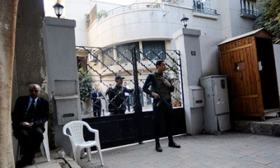 Egyptian soldiers stand guard in front of the US National Democratic Institute, an NGO in Cairo, on 29 December 2011. Photograph: Filippo Monteforte/AFP/Getty