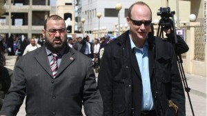 U.S. national Robert Becker, right, leaves court in Cairo after a trial on allegedly illegally funded NGOs on March 8, 2012. - CNN Photo