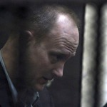American Robert Becker, one of the defendants, is seen in a cage during the early days of the NGO trial in Cairo March 8, 2012. (Reuters)