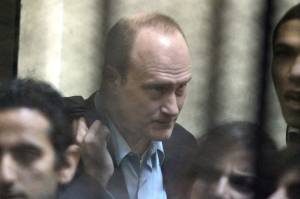 A March 2012 photos shows Robert Becker during his detention in an Egyptian jail, alongside Egyptian NGO workers. (Khaled Desouki/AFP/Getty Images)